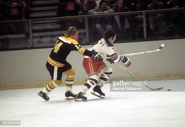 Garnet 'Ace' Bailey of the Boston Bruins chases Rod Gilbert of the New York Rangers during an NHL game circa 1972 at the Madison Square Garden in New...