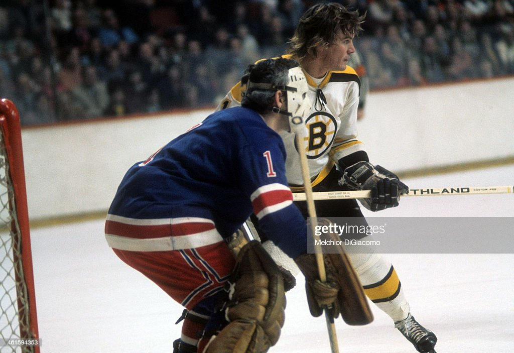Garnet 'Ace' Bailey of the Boston Bruins sets up in front of goalie Ed Giacomin of the New York Rangers during an NHL game circa 1972 at the Boston...