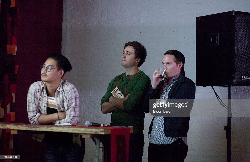 Garnish Allan startup co-founders Allan Yu, from left, Scott Rogers, and Eli Rousso listen during the Brooklyn Beta conference in the Brooklyn borough of New York, U.S., on Friday, Oct. 12, 2012. Brooklyn Beta is a small web conference aimed at gathering web designers, developers, and entrepreneurs together to discuss meaningful problems in the industry. Photographer: Mark Ovaska/Bloomberg via Getty Images