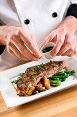 Garnishing a Steak Dinner