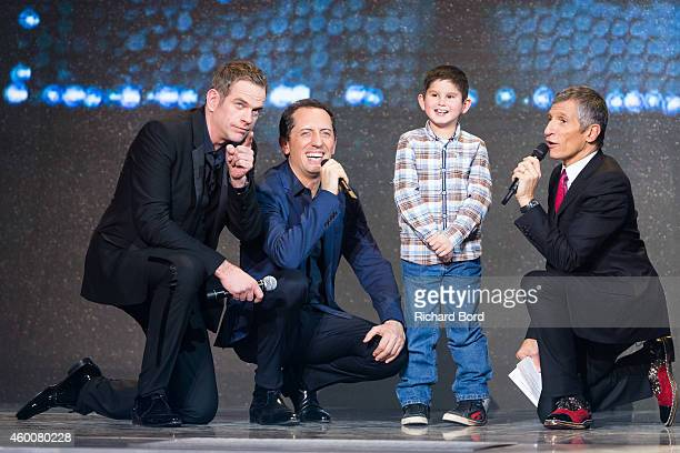 Garou Gad Elmaleh a child and presenter Nagui attend the 'France Television Telethon 2014' TV show on December 6 2014 in Paris France