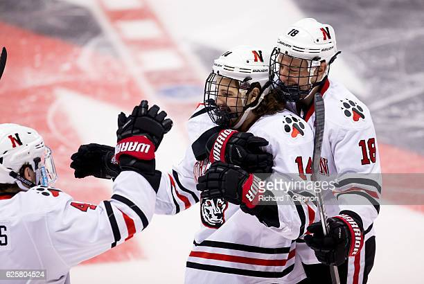 Garret Cockerill of the Northeastern Huskies celebrates his goal with his teammates John Stevens and Jeremy Davies against the Minnesota Golden...