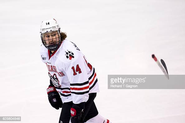 Garret Cockerill of the Northeastern Huskies loses his stick in the middle of his goal celebration against Eric Schierhorn of the Minnesota Golden...