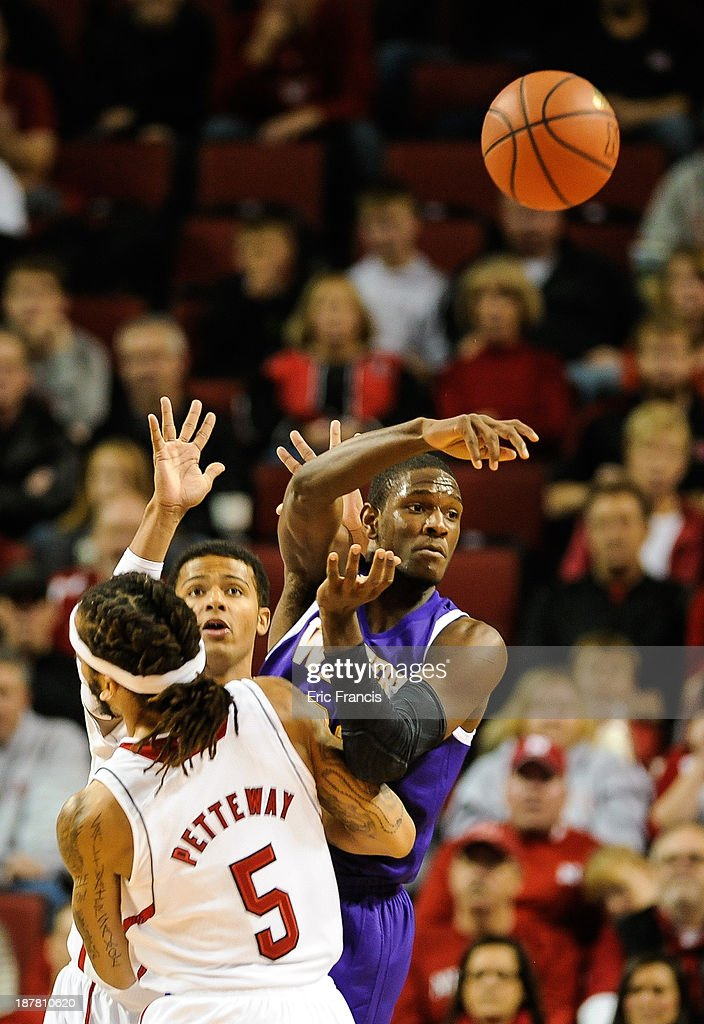 Garret Covington #31 of the Western Illinois Leathernecks passes the ball over Terran Petteway #5 of the Nebraska Cornhuskers during their game at Pinnacle Bank Arena on November 12, 2013 in Lincoln, Nebraska.