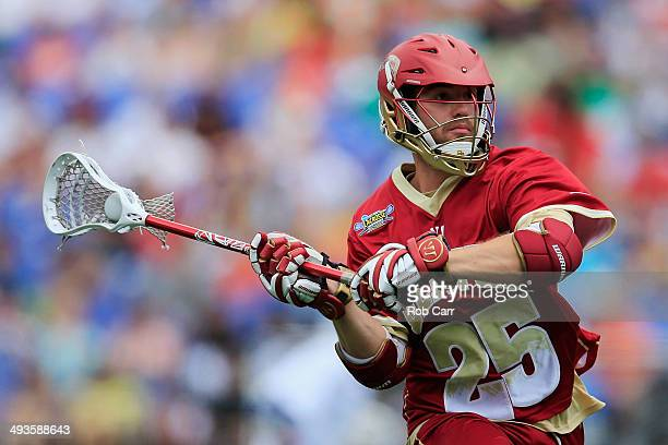 Garret Holst of the Denver Pioneers passes the ball against the Duke Blue Devils during the semifinals of the 2014 NCAA Division I Men's Lacrosse...