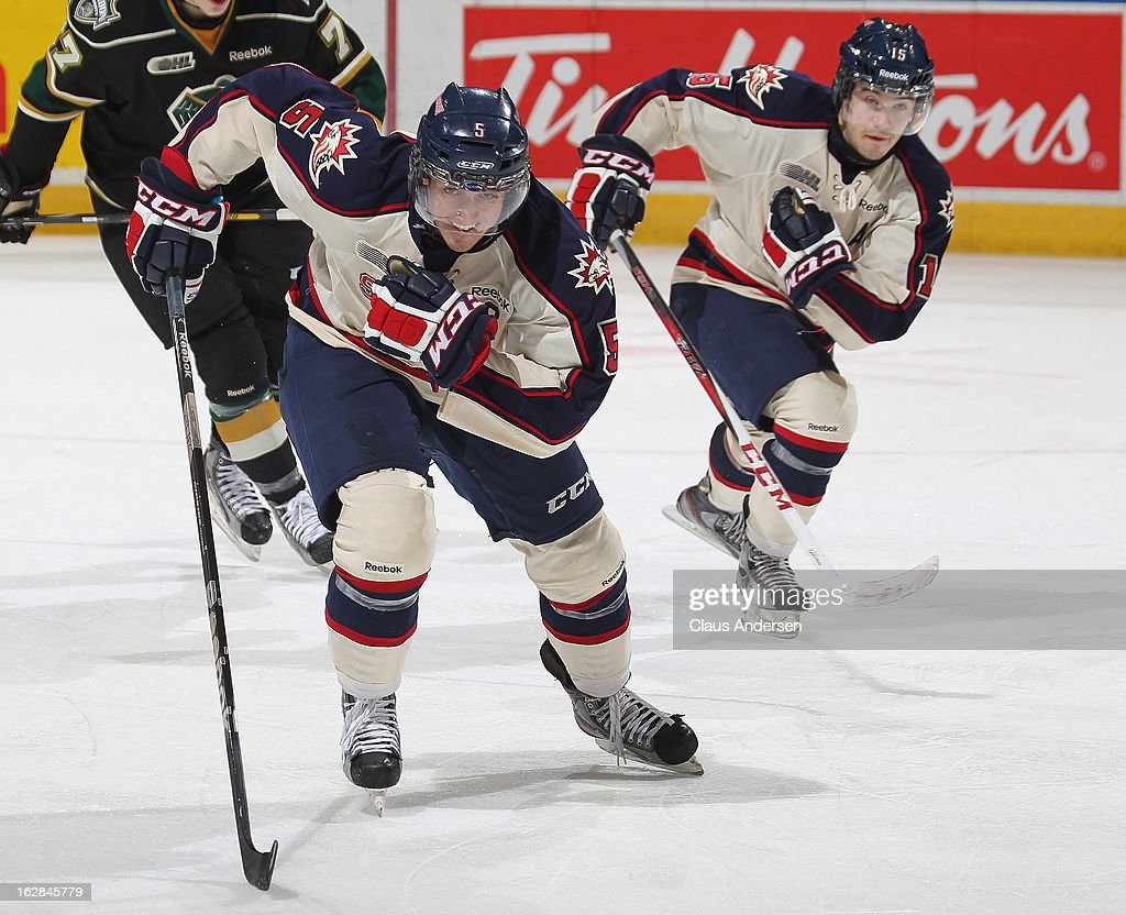 Garret Ross #5 and Eric Locke #15 of the Saginaw Spirit skate back in an OHL game against the London Knights on February 24, 2013 at the Budweiser Gardens in London, Ontario, Canada. The Knights defeated the Spirit 3-2.