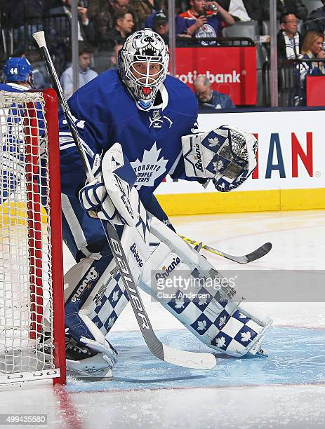 Garret Sparks of the Toronto Maple Leafs checks the corner against the Edmonton Oilers during an NHL game at Air Canada Centre on November 30 2015 in...