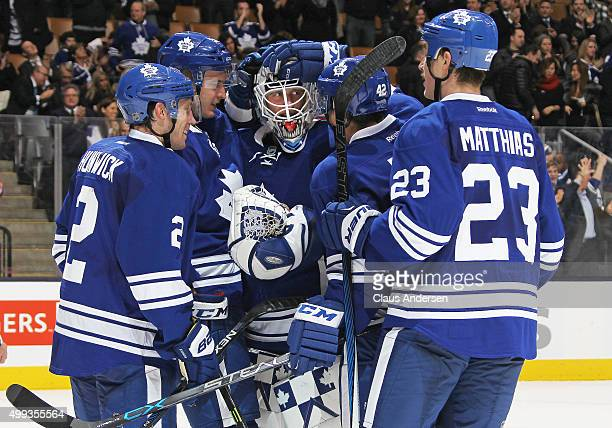 Garret Sparks of the Toronto Maple Leafs is congratulated by his teammates after earning a shutout in his 1st NHL game against the Edmonton Oilers in...