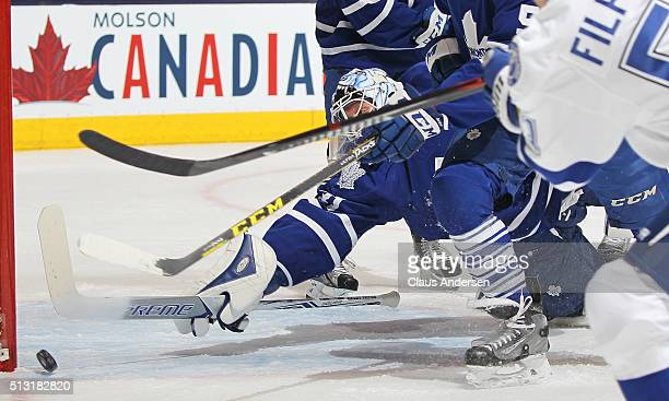 Garret Sparks of the Toronto Maple Leafs makes a huge save against the Tampa Bay Lightning during an NHL game at the Air Canada Centre on February 29...