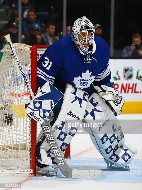 Garret Sparks of the Toronto Maple Leafs prepares for a shot against during game action on November 30 2015 at Air Canada Centre in Toronto Ontario...