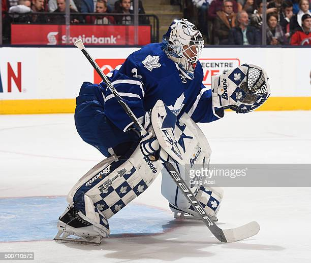 Garret Sparks of the Toronto Maple Leafs prepares for a shot against the New Jersey Devils during game action on December 8 2015 at Air Canada Centre...