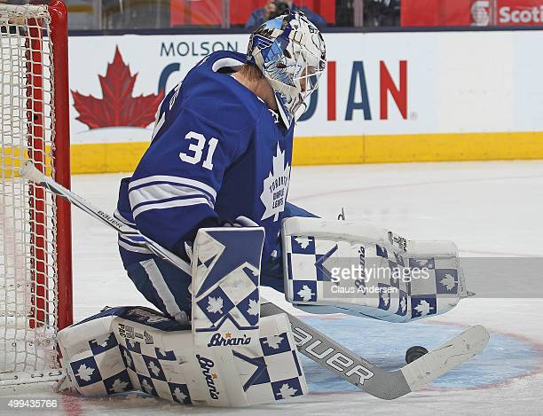 Garret Sparks of the Toronto Maple Leafs stops a shot against the Edmonton Oilers during an NHL game at Air Canada Centre on November 30 2015 in...