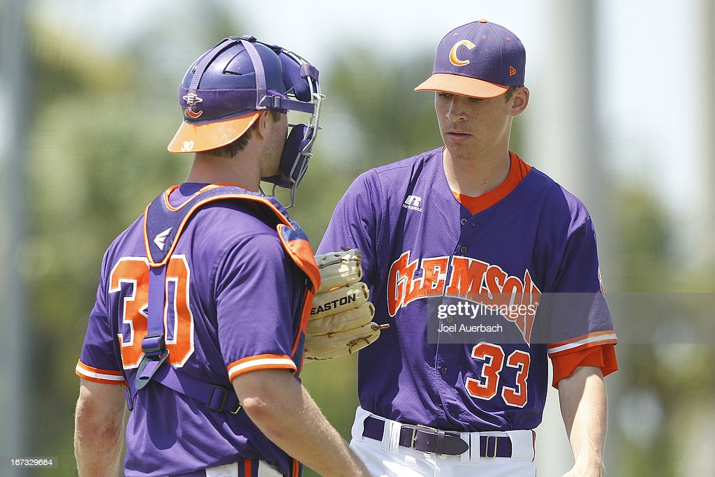 Garrett Boulware #30 talks to Zack Erwin #33 of the Clemson Tigers after he allowed a run by the Miami Hurricanes in the fourth inning on April 21, 2013 at Alex Rodriguez Park at Mark Light Field in Coral Gables, Florida. Miami defeated Clemson 7-0.