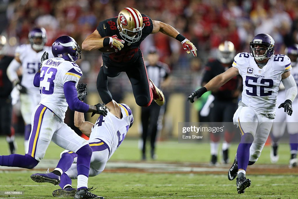 Garrett Celek #88 of the San Francisco 49ers is hit after a catch in the first half of their NFL game against the Minnesota Vikings at Levi's Stadium on September 14, 2015 in Santa Clara, California.
