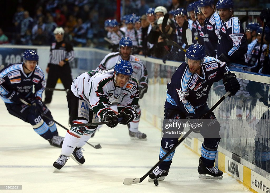Garrett Festerling of Hamburg battles for the puck with Michael Bakos of Augsburg during the DEL match between Hamburg Freezers and Augsburger...