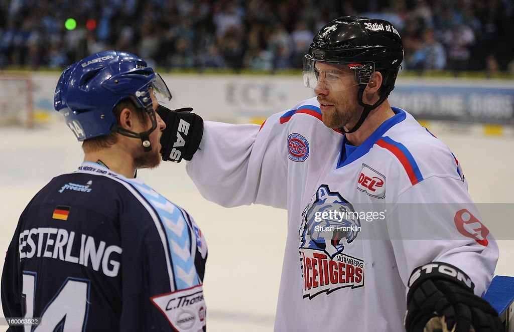 Garrett Festerling of Hamburg talks with his brother Brett Festerling of the Ice Tiger during the DEL game between Hamburg Freezers and Thomas Sabo Ice Tigers at O2 World on January 25, 2013 in Hamburg, Germany.