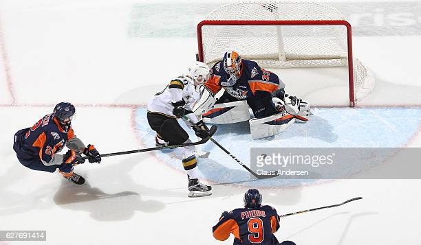 Garrett Forrest of the Flint Firebirds faces a scoring attempt by Alex Formenton of the London Knights during an OHL game at Budweiser Gardens on...