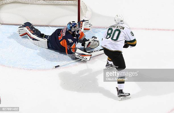 Garrett Forrest of the Flint Firebirds stops Alex Formenton of the London Knights during an OHL game at Budweiser Gardens on December 4 2016 in...