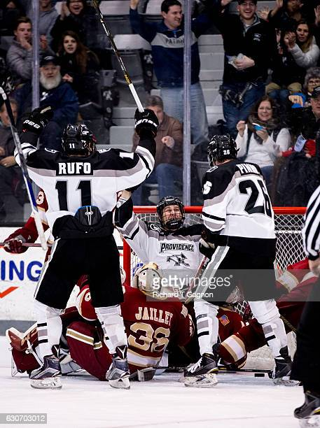 Garrett Gamez of the Providence College Friars celebrates his goal against Tanner Jaillet of the Denver Pioneers with his teammates Niko Rufo and...