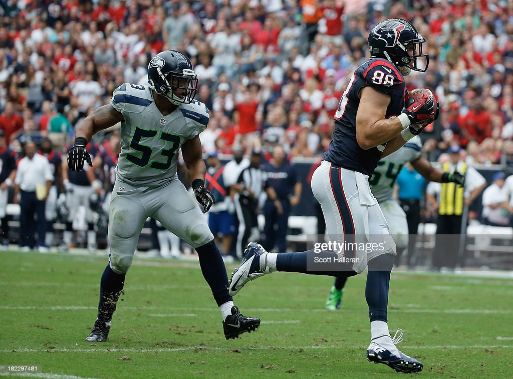 <a gi-track='captionPersonalityLinkClicked' href=/galleries/search?phrase=Garrett+Graham&family=editorial&specificpeople=4500875 ng-click='$event.stopPropagation()'>Garrett Graham</a> #88 of the Houston Texans hauls in a 31 yard second quarter touchdown against the Seattle Seahawks at Reliant Stadium on September 29, 2013 in Houston, Texas.