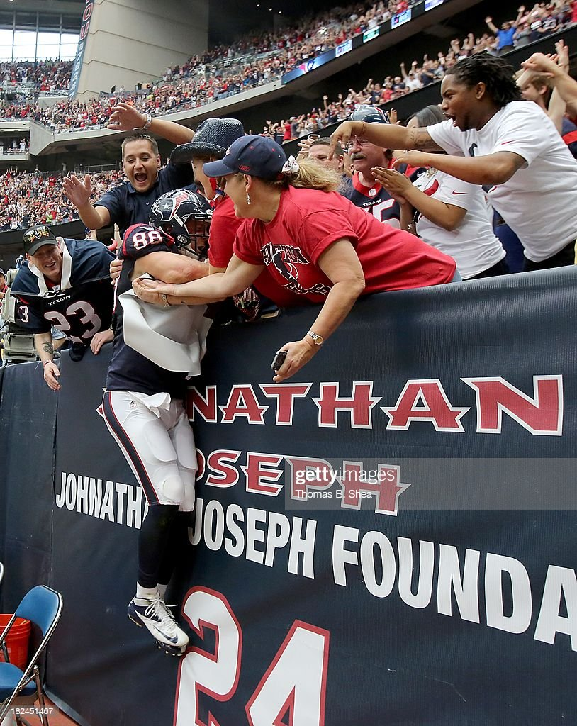 Garrett Graham #88 of the Houston Texans jumps into the stands after catching a touchdown pass against the Seattle Seahawks on September 29, 2013 at Reliant Stadium in Houston, Texas.