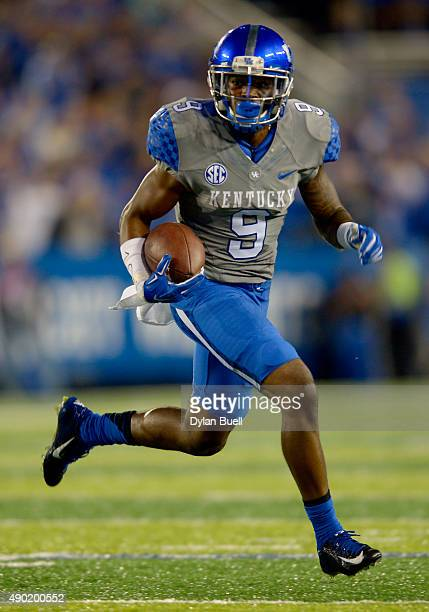 Garrett Johnson of the Kentucky Wildcats heads towards the end zone during the second half against the Missouri Tigers at Commonwealth Stadium on...