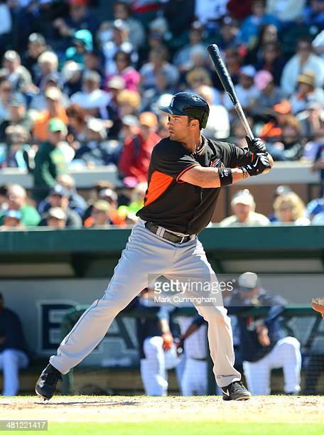 Garrett Jones of the Miami Marlins bats during the spring training game against the Detroit Tigers at Joker Marchant Stadium on March 13 2014 in...