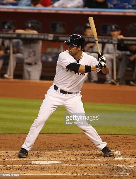 Garrett jones of the Miami Marlins drives in a run against the Colorado rockies during the second inning at Marlins Park on April 2 2014 in Miami...