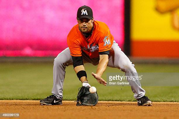 Garrett Jones of the Miami Marlins fields a ground ball during the game against the Philadelphia Phillies at Citizens Bank Park on April 12 2014 in...