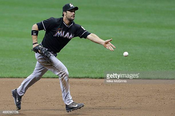 Garrett Jones of the Miami Marlins flips the ball to first base to retire Lyle Overbay of the Milwaukee Brewers during the bottom of the sixth inning...