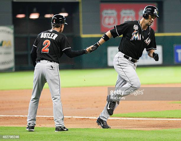 Garrett Jones of the Miami Marlins hits a home run in the first inning against the Houston Astros at Minute Maid Park on July 27 2014 in Houston Texas