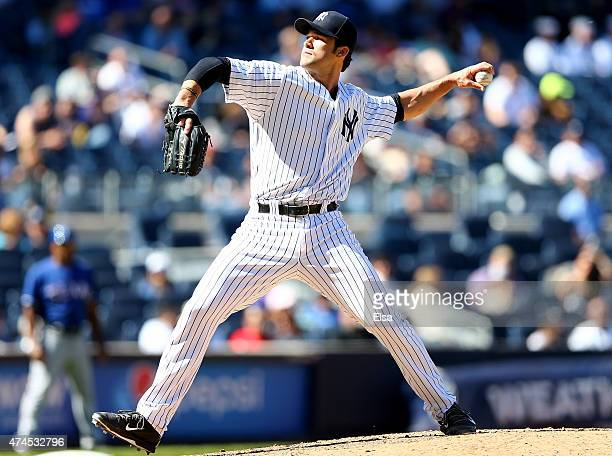 Garrett Jones of the New York Yankees delivers a pitch in the ninth inning against the Texas Rangers on May 23 2015 at Yankee Stadium in the Bronx...