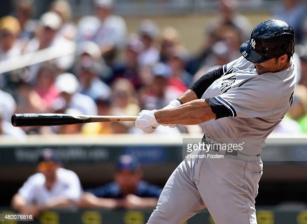 Garrett Jones of the New York Yankees hits an RBI single against the Minnesota Twins during the sixth inning of the game on July 26 2015 at Target...