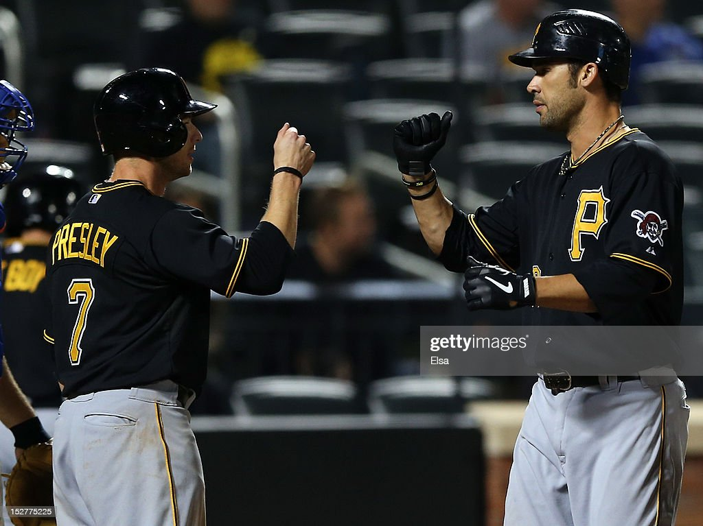 <a gi-track='captionPersonalityLinkClicked' href=/galleries/search?phrase=Garrett+Jones&family=editorial&specificpeople=835861 ng-click='$event.stopPropagation()'>Garrett Jones</a> #46 of the Pittsburgh Pirates celebrates his two run homer with teammate Alex Presley #7 in the ninth inning against the New York Mets on September 25, 2012 at Citi Field in the Flushing neighborhood of the Queens borough of New York City.