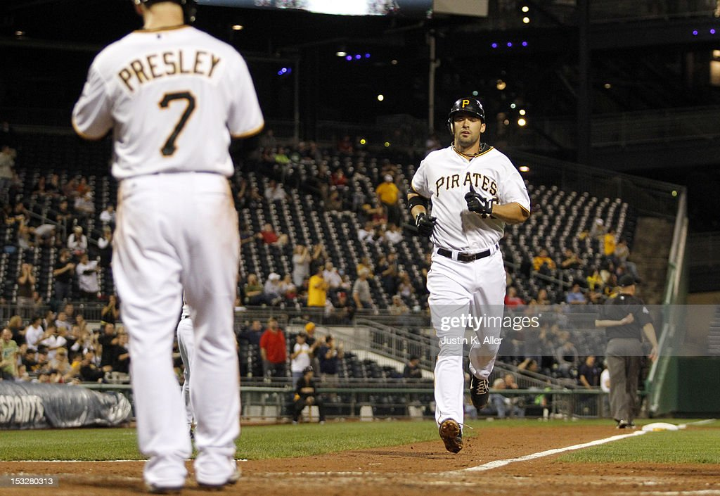 <a gi-track='captionPersonalityLinkClicked' href=/galleries/search?phrase=Garrett+Jones&family=editorial&specificpeople=835861 ng-click='$event.stopPropagation()'>Garrett Jones</a> #46 of the Pittsburgh Pirates crosses home after hitting a two run home run in the fifth inning against the Atlanta Braves during the game on October 2, 2012 at PNC Park in Pittsburgh, Pennsylvania.