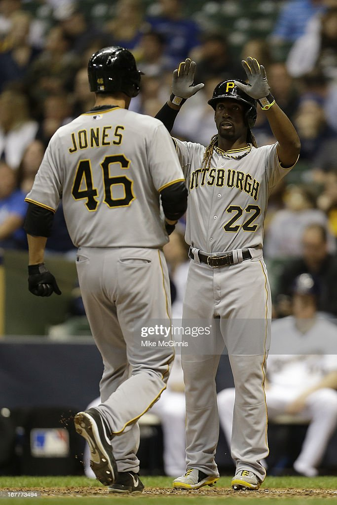 <a gi-track='captionPersonalityLinkClicked' href=/galleries/search?phrase=Garrett+Jones&family=editorial&specificpeople=835861 ng-click='$event.stopPropagation()'>Garrett Jones</a> #46 of the Pittsburgh Pirates crosses home plate after hitting a two-run homer scoring <a gi-track='captionPersonalityLinkClicked' href=/galleries/search?phrase=Andrew+McCutchen&family=editorial&specificpeople=2364814 ng-click='$event.stopPropagation()'>Andrew McCutchen</a> #22 during the top of the 8th inning against the Milwaukee Brewers at Miller Park on April 29, 2013 in Milwaukee, Wisconsin.