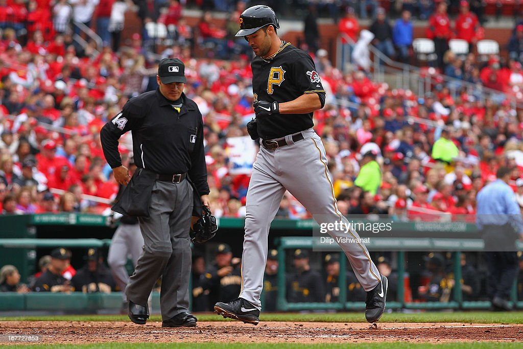 <a gi-track='captionPersonalityLinkClicked' href=/galleries/search?phrase=Garrett+Jones&family=editorial&specificpeople=835861 ng-click='$event.stopPropagation()'>Garrett Jones</a> #46 of the Pittsburgh Pirates crosses the plate after hitting a solo home run off of Fernando Salas #59 of the St. Louis Cardinals in the seventh inning at Busch Stadium on April 28, 2013 in St. Louis, Missouri. The Pirates beat the Cardinals 9-0.