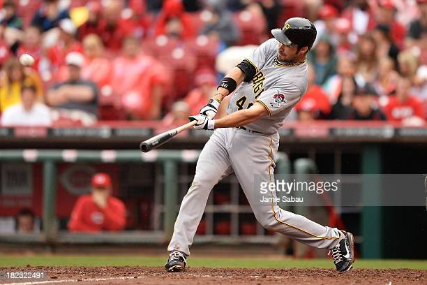 Garrett Jones of the Pittsburgh Pirates hits a solo home run in the eighth inning against the Cincinnati Reds at Great American Ball Park on...