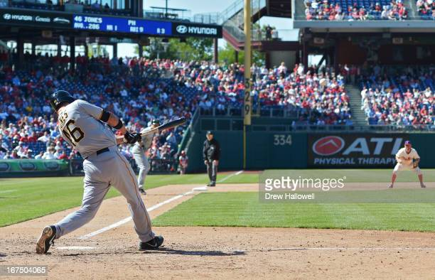 Garrett Jones of the Pittsburgh Pirates hits a two run double in the eighth inning against the Philadelphia Phillies at Citizens Bank Park on April...