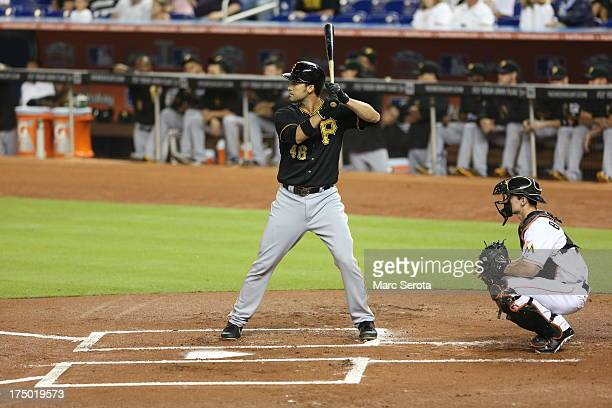 Garrett Jones of the Pittsburgh Pirates hits against the Miami Marlins at Marlins Park on July 27 2013 in Miami Florida The Pirates defeated the...