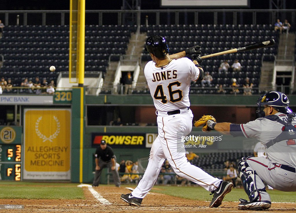 Garrett Jones #46 of the Pittsburgh Pirates hits an RBI double in the fifth inning against the Atlanta Braves during the game on April 18, 2013 at PNC Park in Pittsburgh, Pennsylvania.