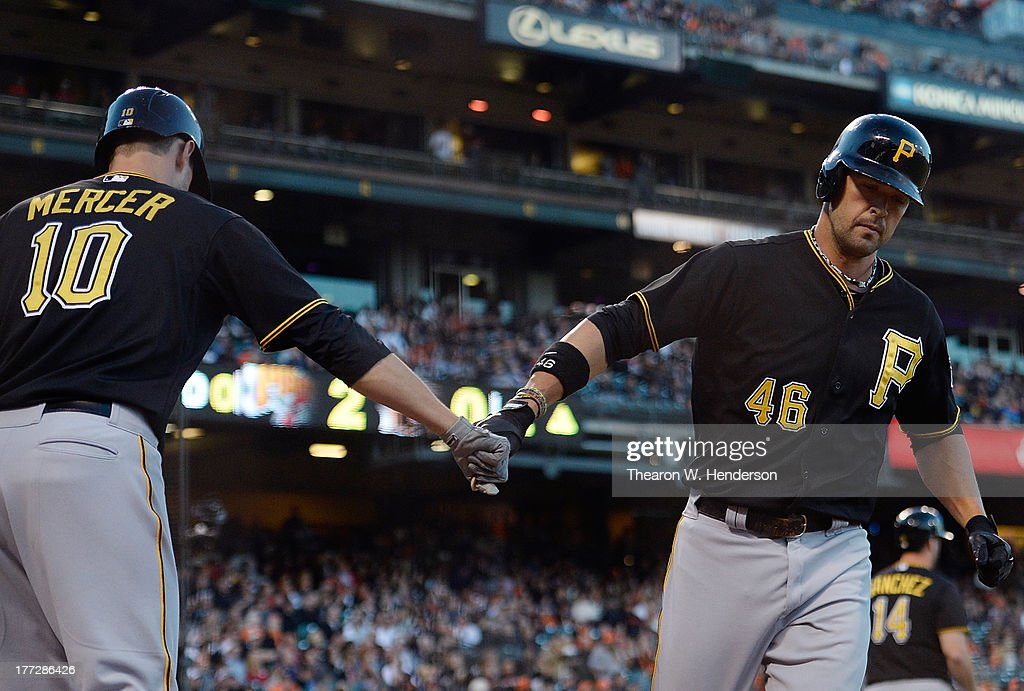 <a gi-track='captionPersonalityLinkClicked' href=/galleries/search?phrase=Garrett+Jones&family=editorial&specificpeople=835861 ng-click='$event.stopPropagation()'>Garrett Jones</a> #46 of the Pittsburgh Pirates is congratulated by Jordy Mercer #10 after Jones hit a solo home run in the second inning against the San Francisco Giants at AT&T Park on August 22, 2013 in San Francisco, California.