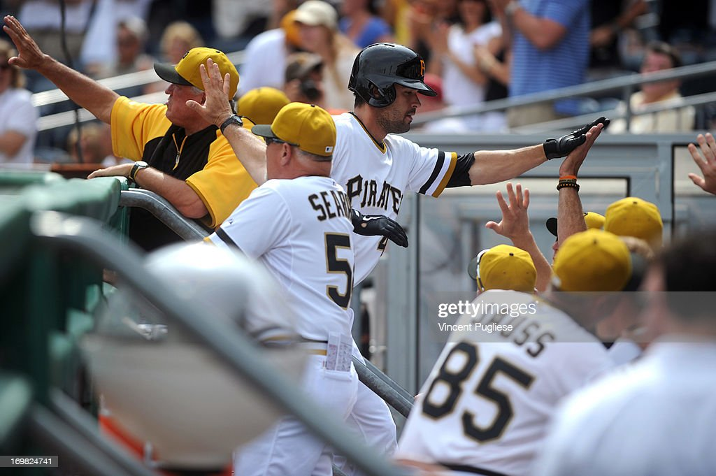 <a gi-track='captionPersonalityLinkClicked' href=/galleries/search?phrase=Garrett+Jones&family=editorial&specificpeople=835861 ng-click='$event.stopPropagation()'>Garrett Jones</a> #46 of the Pittsburgh Pirates is greeted by his teammates after hitting a home run to tie the game at 4-4 in the eighth inning against the Cincinnati Reds at PNC Park on June 2, 2013 in Pittsburgh, Pennsylvania.