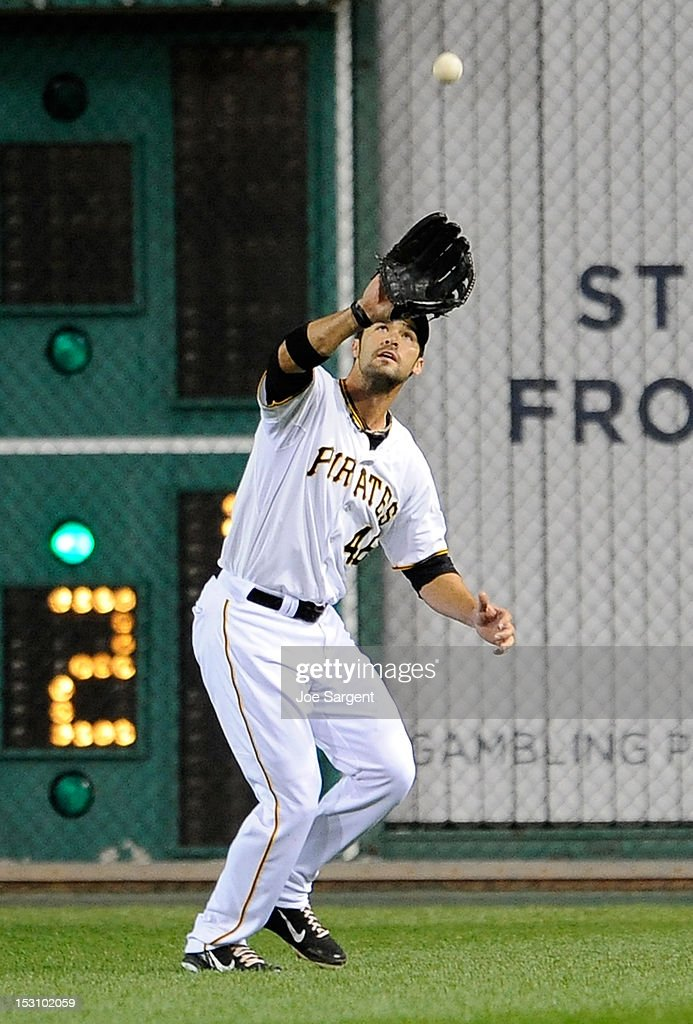<a gi-track='captionPersonalityLinkClicked' href=/galleries/search?phrase=Garrett+Jones&family=editorial&specificpeople=835861 ng-click='$event.stopPropagation()'>Garrett Jones</a> #46 of the Pittsburgh Pirates makes a catch on a ball hit by Chris Heisey #28 of the Cincinnati Reds on September 29, 2012 at PNC Park in Pittsburgh, Pennsylvania. Pittsburgh won the game 2-1.