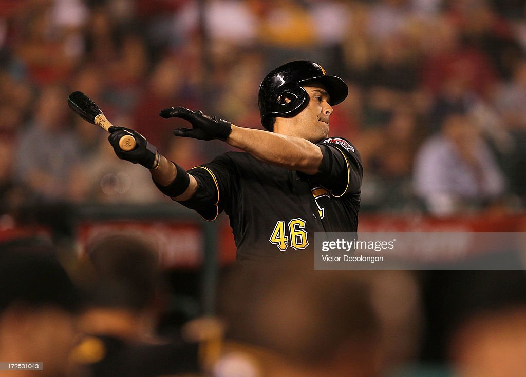 <a gi-track='captionPersonalityLinkClicked' href=/galleries/search?phrase=Garrett+Jones&family=editorial&specificpeople=835861 ng-click='$event.stopPropagation()'>Garrett Jones</a> #46 of the Pittsburgh Pirates practices his swing on deck in the ninth inning during the MLB game against the Los Angeles Angels of Anaheim at Angel Stadium of Anaheim on June 21, 2013 in Anaheim, California. The Pirates defeated the Angels 5-2.
