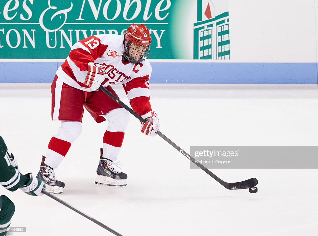 Garrett Noonan #13 of the Boston University Terriers skates against the Dartmouth College Big Green during NCAA hockey action at Agganis Arena on January 8, 2014 in Boston, Massachusetts.
