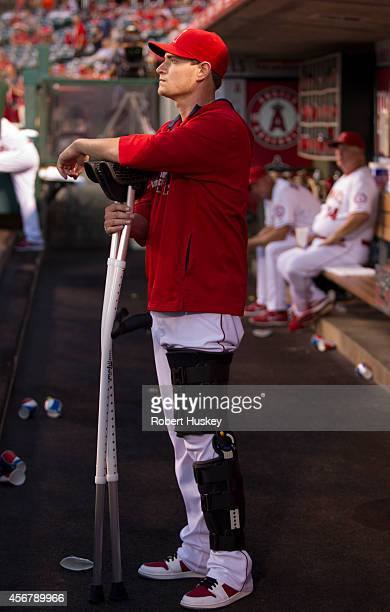 Garrett Richards of the Los Angeles Angels of Anaheim leans on his crutches in the dugout before the game against the Seattle Mariners on September...