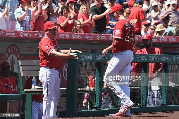 Garrett Richards of the Los Angeles Angels of Anaheim leaves the game in the seventh inning against the Houston Astros at Angel Stadium of Anaheim on...