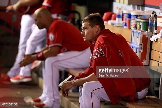 Garrett Richards of the Los Angeles Angels of Anaheim sits in the dugout after being relieved by Jose Alvarez of the Los Angeles Angels of Anaheim...