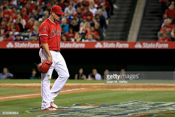 Garrett Richards of the Los Angeles Angels of Anaheim throws walks to the dugout after being relieved by Jose Alvarez of the Los Angeles Angels of...